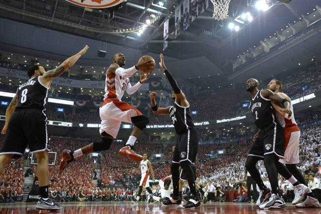 The Toronto Raptors' Terrence Ross (31) drives to the net against the Brooklyn Nets' Deron Williams (8) and Paul Pierce (34) as the Nets' Kevin Garnett (2) boxes out the Raptors' Jonas Valanciunas during the first half of Game 7 of the opening-round NBA basketball playoff series in Toronto on Sunday, May 4, 2014.