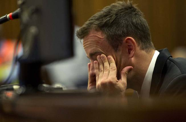 Oscar Pistorius reacts as he listens to evidence by a pathologist in court in Pretoria, South Africa, on April 7, 2014. The murder trial of Pistorius is expected to enter a crucial phase of testimony Monday as the defense attempts to overcome a faltering start and show how the disabled Olympic athlete fatally shot girlfriend Reeva Steenkamp by mistake because he was overwhelmed by a long-held fear of violent crime.