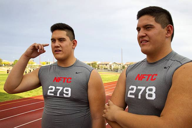 Las Vegas High offensive linemen Mark Gil Gacutan, left, and Mark Anthony Gacutan respond to questions during an interview at Las Vegas High School on Monday, May 5, 2014. Doctors initially thought they had gigantism, abnormally large growth due to an excess of growth hormone, because they grew so fast, they said.