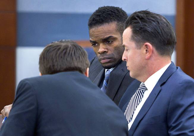 "Jason ""Blu"" Griffith, center, the man accused of killing Luxor ""Fantasy"" dancer Debora Flores Narvaez, listens to defense attorneys Abel Yanez, left, and Jeff Banks before the start of jury selection, at the Regional Justice Center Monday, May 5, 2014."