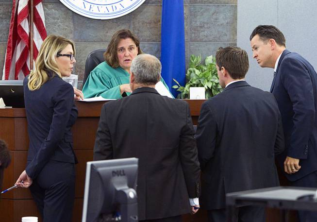 "District Court Judge Kathleen Delaney confers with attorneys as jury selection begins in the trial for Jason ""Blu"" Griffith, the man accused of killing Luxor ""Fantasy"" dancer Debora Flores Narvaez, at the Regional Justice Center Monday, May 5, 2014."