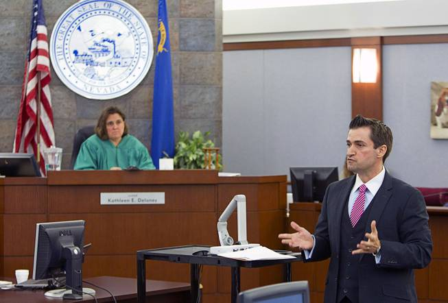 "Defense attorney Abel Yanez , right, speaks to potential jurors as jury selection begins in the trial for Jason ""Blu"" Griffith, the man accused of killing Luxor ""Fantasy"" dancer Debora Flores Narvaez, at the Regional Justice Center Monday, May 5, 2014. District Court Judge Kathleen Delaney is in the background."