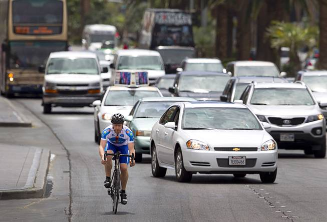 "James Lyne, global head of security research at Sophos, goes ""war biking"" on the Las Vegas Strip Monday, May 5, 2014. His bicycle is equipped with a scanner and computer that can detect Wi-Fi networks. Sophos is a British-based Internet security company."