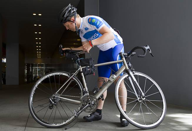 "James Lyne, global head of security research at Sophos, prepares to go ""war biking"" on the Las Vegas Strip Monday, May 5, 2014. His bicycle is equipped with a scanner and computer that can detect Wi-Fi networks."