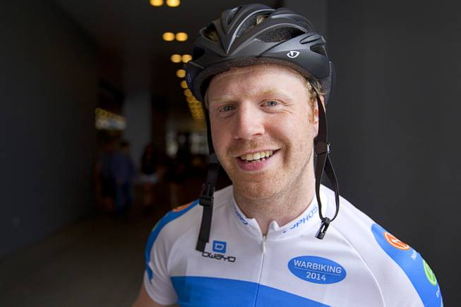 "James Lyne, global head of security research at Sophos, poses before going ""war biking"" in Las Vegas Monday, May 5, 2014. His bicycle is equipped with a scanner and computer that can detect Wi-Fi networks."