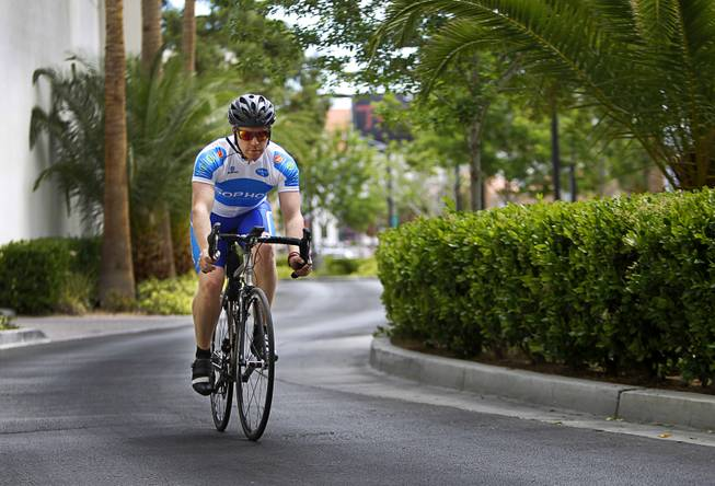 "James Lyne, global head of security research at Sophos, rides by the Hard Rock Hotel as he goes ""war biking"" Monday, May 5, 2014. His bicycle is equipped with a scanner and computer that can detect Wi-Fi networks."