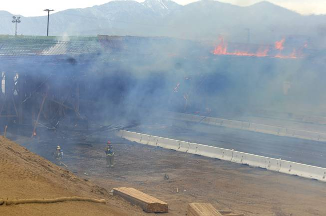 The construction site at Interstate 15 was engulfed in flames on Monday, May 5, 2014, in Hesperia, Calif. The California Highway Patrol's Carlos Juarez says the bridge at Ranchero Road caught fire at about 1:30 p.m. and Interstate 15 was closed soon after because of falling debris.