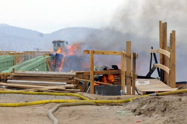The construction site of the Ranchero Interchange Bridge at Interstate 15 was engulfed in flames on Monday, May 5, 2014, in Hesperia, Calif. The California Highway Patrol's Carlos Juarez says the bridge at Ranchero Road caught fire at about 1:30 p.m. and Interstate 15 was closed soon after because of falling debris.