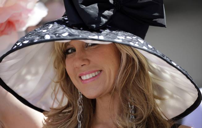 Hope Lach of Orlando, Fla., smiles before the 140th running of the Kentucky Derby horse race at Churchill Downs Saturday, May 3, 2014, in Louisville, Ky.