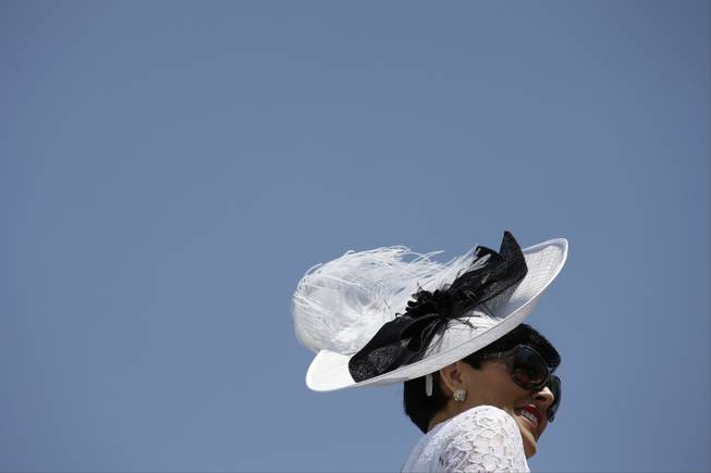 Sharon Ainslie looks around the paddock before the 140th running of the Kentucky Derby horse race at Churchill Downs Saturday, May 3, 2014, in Louisville, Ky. (AP Photo/David J. Phillip)