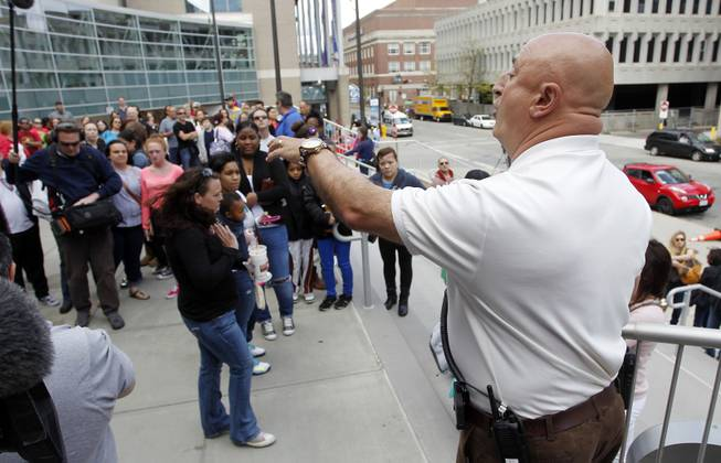 Tony Feola, right, with the Dunkin' Donuts Center security department, informs the crowd that the 3:00 p.m. and 7:00 p.m. shows of the Ringling Bros. and Barnum & Bailey Circus are canceled, Sunday, May 4, 2014, in Providence, R.I.