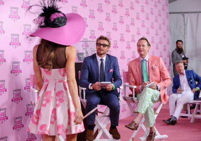 IMCelebrity judges Simon Baker, center, and Carson Kressley, right, judge the Longines Kentucky Oaks Fashion Contest on Kentucky Oaks Day, Friday, May 2, 2014, in Louisville, Ky.  Longines, the Swiss watch manufacturer known for its luxury timepieces, is the Official Watch and Timekeeper of the 140th annual Kentucky Derby.