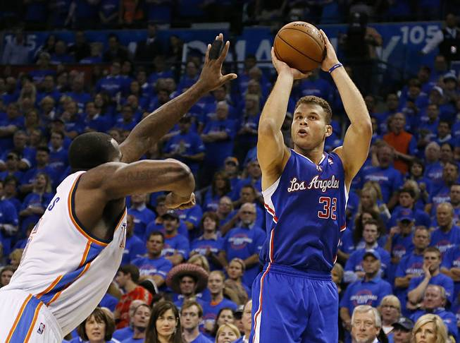 Los Angeles Clippers forward Blake Griffin, right, shoots over Oklahoma City Thunder center Kendrick Perkins, left, in the first quarter of Game 1 of the Western Conference semifinal NBA basketball playoff series in Oklahoma City, Monday, May 5, 2014.