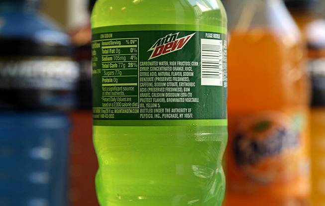 The ingredients on a bottle of Mountain Dew are photographed in San Francisco on Monday, May 5, 2014. Coca-Cola said Monday that it will drop brominated vegetable oil from all of its drinks that contain it and not just Powerade.
