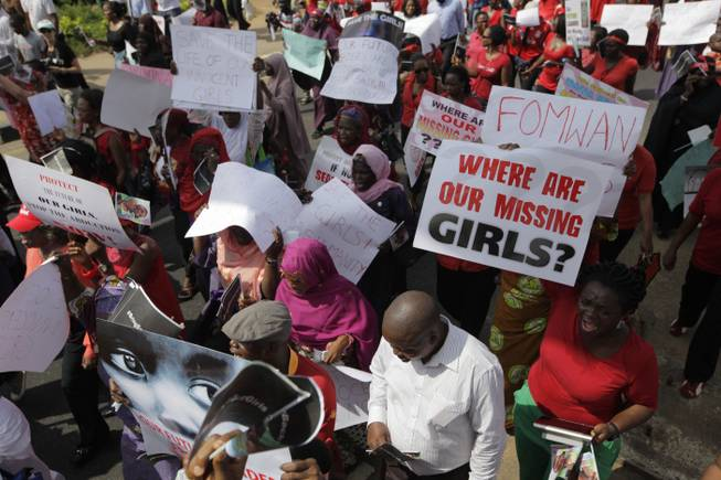 Women attend a mass-demonstration calling on the government to increase efforts to rescue the hundreds of missing kidnapped school girls of a government secondary school Chibok, in Lagos, Nigeria, Monday, May 5, 2014