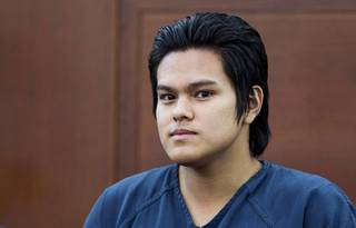 Jeremy Espiritu, 22, appears in court before his sentencing at the Regional Justice Center on Tuesday, May 6, 2014. Espiritu told police that he stabbed the family dog, Serenity, with a six-inch serrated knife because he