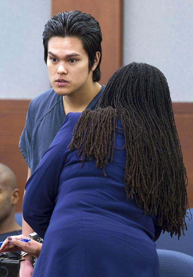 "Jeremy Espiritu, 22, listens to defense attorney Donishia Campbell during sentencing at the Regional Justice Center Tuesday, May 6, 2014. Espiritu told police that he stabbed the family dog, Serenity, with a six-inch serrated knife because he ""wanted to."" The dog later died of the injury."