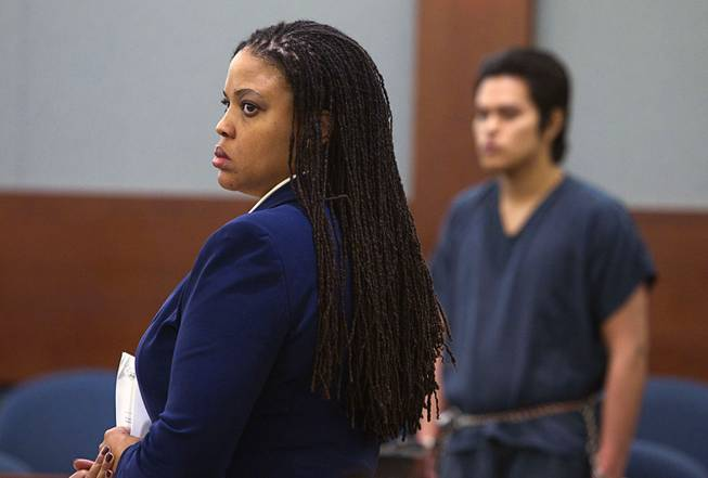 "Defense attorney Donishia Campbell, left, represents Jeremy Espiritu, 22, during sentencing at the Regional Justice Center Tuesday, May 6, 2014. Espiritu told police that he stabbed the family dog, Serenity, with a six-inch serrated knife because he ""wanted to."" The dog later died of the injury."