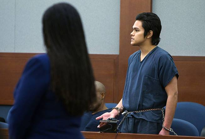 "Jeremy Espiritu, 22, responds to a question from Judge Jerome Tao during sentencing at the Regional Justice Center Tuesday, May 6, 2014. Espiritu told police that he stabbed the family dog, Serenity, with a six-inch serrated knife because he ""wanted to."" The dog later died of the injury."
