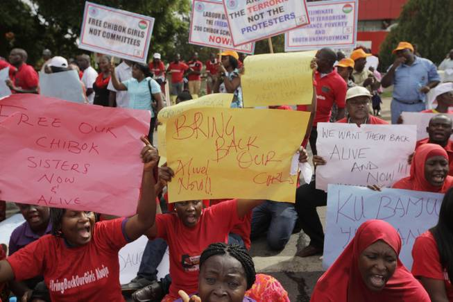 Women attend a demonstration calling on the government to rescue kidnapped schoolgirls of Chibok  secondary school  outside the defense  headquarters, in Abuja,  Nigeria Tuesday, May 6 2014.