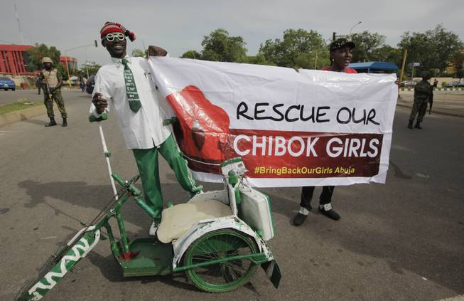 A man attends a demonstration calling on the government to rescue the kidnapped school girls of a government secondary school Chibok, outside the defense headquarters in Abuja, Nigeria, Tuesday May 6, 2014.