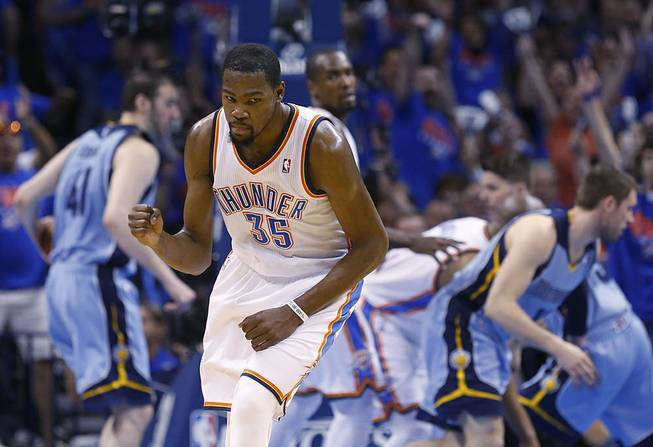 Oklahoma City Thunder forward Kevin Durant (35) pumps his fist as he heads back up the court following a three-pointer in the second quarter of Game 7 of an opening-round NBA basketball playoff series against the Memphis Grizzlies in Oklahoma City, Saturday, May 3, 2014.