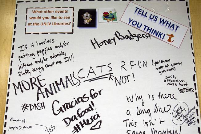 "A message board shows comments from students during ""Paws"" for a Study Break at UNLV's Lied Library Wednesday, May 7, 2014. The library sponsored the second annual study break with certified therapy dogs from Love Dog Adventures to help calm students stressing over final exams."