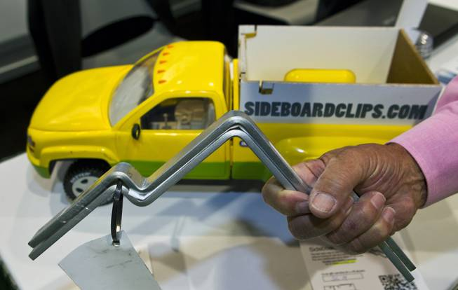 Sideboard Clips are the fast, easy way to secure sideboards without having to use any tools and are being displayed at the National Hardware Show 2014 in the Las Vegas Convention Center on Wednesday, May 7, 2014.   L.E. Baskow