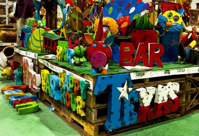 Colorful yard art abounds at the National Hardware Show 2014 in the Las Vegas Convention Center on Wednesday, May 7, 2014.   L.E. Baskow