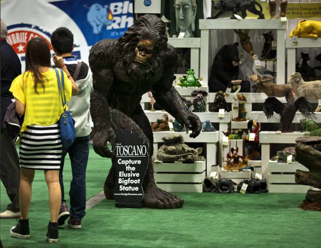 Visitors are stopped by the sight of Bigfoot, the Garden Yeti, on display by Design Toscano during the National Hardware Show 2014 in the Las Vegas Convention Center on Wednesday, May 7, 2014.   L.E. Baskow