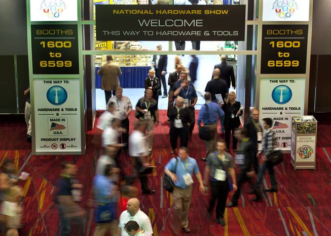 Attendees and staff stream about an entrance to the National Hardware Show 2014 in the Las Vegas Convention Center on Wednesday, May 7, 2014.   L.E. Baskow