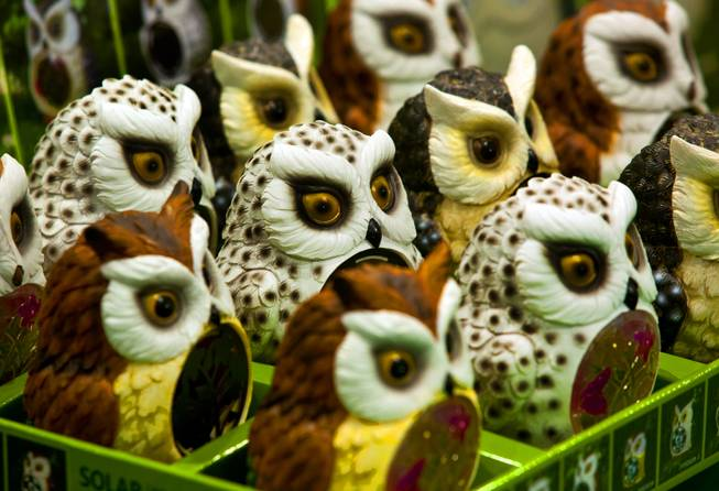 Solar-powered owls from Tianjin HC Hardware Products are lined up on display at the National Hardware Show 2014 in the Las Vegas Convention Center on Wednesday, May 7, 2014.   L.E. Baskow