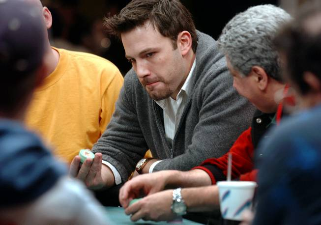 Actor Ben Affleck plays a hand of poker during The Showdown at the Sands, a $1 million poker tournament, at the Sands Casino Hotel in Atlantic City, N.J., Saturday, Nov. 22, 2003.