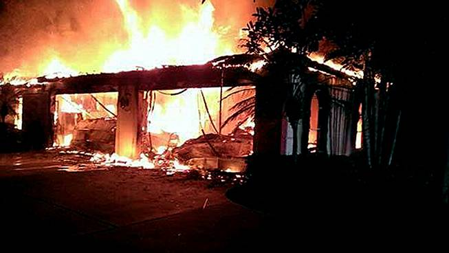 In this photo provided by the Hillsborough County Sheriff's Office, flames destroy a mansion owned by former tennis star James Blake Wednesday, May 7, 2014, in a gated community in Tampa, Fla.
