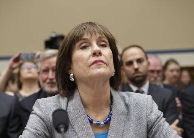 In this May 22, 2013, file photo, Internal Revenue Service official Lois Lerner refuses to answer questions as the House Oversight Committee holds a hearing to investigate the extra scrutiny the IRS gave Tea Party and other conservative groups that applied for tax-exempt status, on Capitol Hill in Washington.