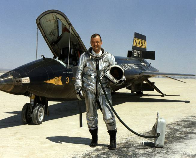 This 1967 file image provided by NASA shows research pilot Bill Dana in front of the X-15 on the dry lake bed at the Dryden Flight Research Center at Edwards Air Force Base, Calif. Dana, the famed research test pilot who flew the X-15 rocket plane and other pioneering aircraft, died Tuesday, May 6, 2014. He was 83.