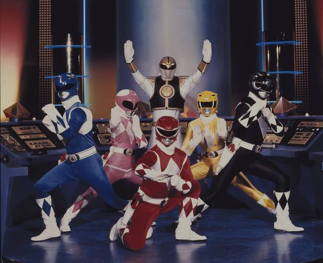 "This publicity file photo provided by Saban Brands, shows a scene from the ""Mighty Morphin Power Rangers"" TV show. Lions Gate Entertainment Corp. said Tuesday, May 6, 2014, it was partnering with Haim Sabanís Saban Entertainment to produce a live-action feature film based on the spandex-wearing, martial arts superheroes who are usually called upon to save the world. ""Power Rangers"" have had a continuous presence on U.S. TV since 1993."