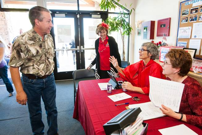 GriefShare facilitator Carol Von Eschen encourages John Robinson to donate blood while working the booth with Kitty Metzger, center, and Brenda Wendling, right, during the blood drive at New Song Church in Henderson Sunday, April 6, 2014.