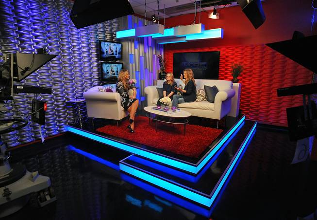 "Fox 5 personality Rachel Smith, left, interviews guests Michelle, from Opportunity Village, center, and Las Vegas performer Veronic DiCaire in the KVVU studios while taping a segment discussing Veronic's new program ""Lend Your Voice"" on Thursday afternoon."