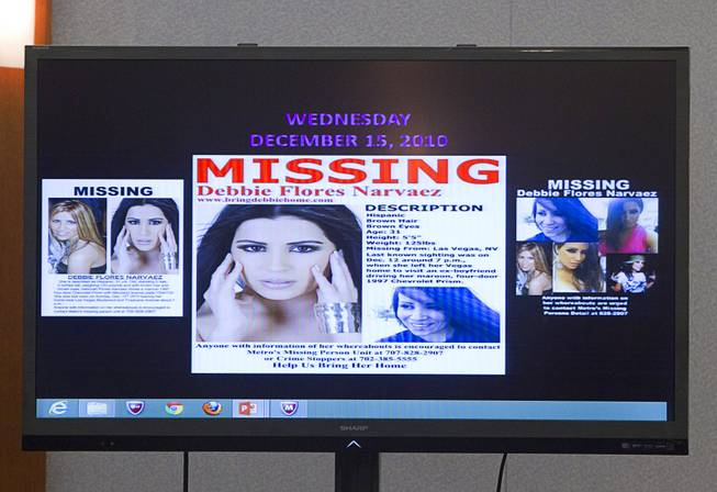 "Missing person fliers are displayed on a video monitor as prosecutor Marc DiGiacomo gives opening statements during the trial for Jason Omar Griffith at the Regional Justice Center Thursday, May 8, 2014. Griffith is accused of murdering Luxor ""Fantasy"" dancer Deborah Flores Narvaez in December 2010."