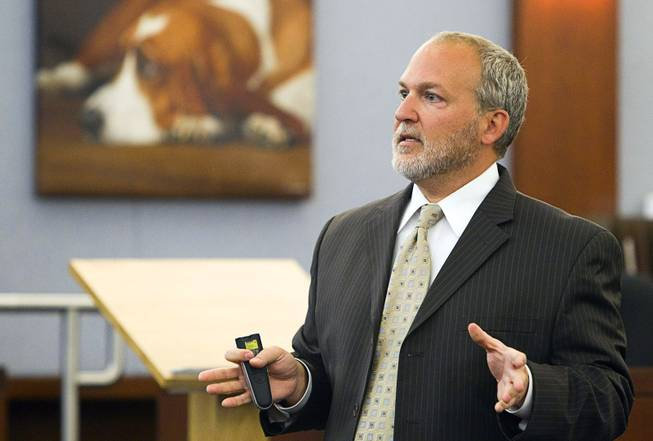 "Prosecutor Marc DiGiacomo gives opening statements during the trial for Jason Omar Griffith at the Regional Justice Center Thursday, May 8, 2014. Griffith is accused of murdering Luxor ""Fantasy"" dancer Deborah Flores Narvaez in December 2010."