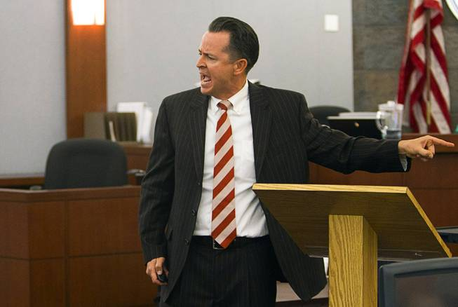 "Defense attorney Jeff Banks points to his client during opening statements during the trial for Jason Omar Griffith at the Regional Justice Center Thursday, May 8, 2014. Griffith is accused of murdering Luxor ""Fantasy"" dancer Deborah Flores Narvaez in December 2010."