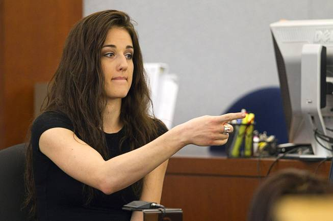 "Sonya Sonnenberg, roommate of Deborah Flores Narvaez, points to defendant Jason Omar Griffith as she testifies during his trial at the Regional Justice Center Thursday, May 8, 2014. Griffith is accused of murdering Luxor ""Fantasy"" dancer Deborah Flores Narvaez in December 2010."
