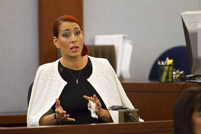 "Celeste Flores Narvaez, sister of Deborah Flores Narvaez, testifies in the trial of Jason Omar Griffith at the Regional Justice Center Thursday, May 8, 2014. Griffith is accused of murdering Luxor ""Fantasy"" dancer Deborah Flores Narvaez in December 2010."