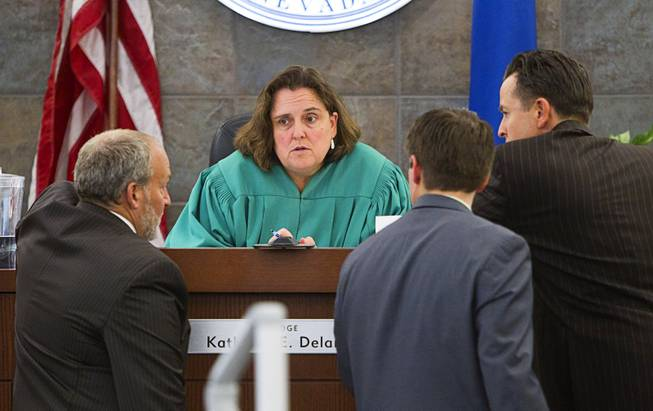 "Judge Kathleen Delaney confers with attorneys during the trial for Jason Omar Griffith at the Regional Justice Center Thursday, May 8, 2014. Griffith is accused of murdering Luxor ""Fantasy"" dancer Deborah Flores Narvaez in December 2010."