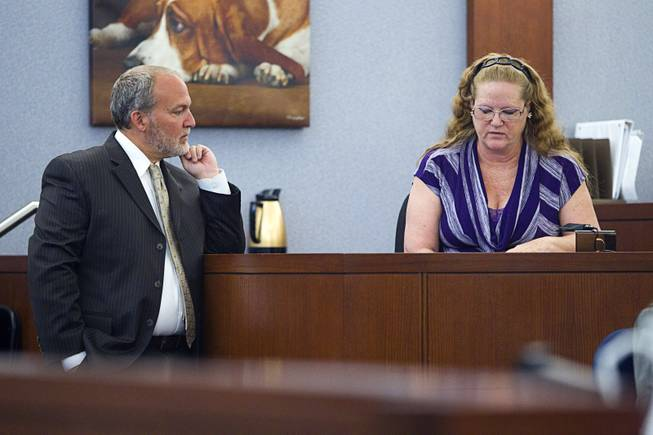"Prosecutor Marc DiGiacomo, left, stand by witness Theresa Howey during a trial for Jason Omar Griffith at the Regional Justice Center Thursday, May 8, 2014. Griffith is accused of murdering Luxor ""Fantasy"" dancer Deborah Flores Narvaez in December 2010. Howey is the person who reported Narvaez' car abandoned in a lot near her house."