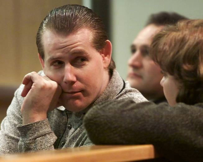 John Butler talks to a member of the court audience during a break in his penalty hearing at the Clark County Courthouse Tuesday, January 2, 2001. Butler was convicted last week of murdering Daniel Shersty, 20, and Lin Newborn, 25, on July 4, 1998.
