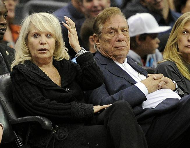 Los Angeles Clippers owner Donald Sterling sits with his wife, Shelly, during a Clippers game against the Detroit Pistons in Los Angeles.