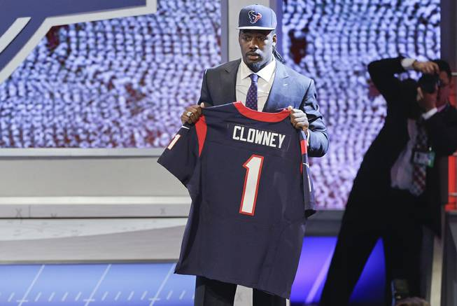 South Carolina defensive end Jadeveon Clowney holds up a jersey for the Houston Texans after being chosen as the first pick in the first round of the 2014 NFL Draft, Thursday, May 8, 2014, in New York.