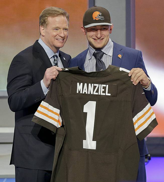 Texas A&M quarterback Johnny Manziel poses with NFL commissioner Roger Goodell after being selected by the Cleveland Browns as the 22nd pick in the first round of the 2014 NFL Draft, Thursday, May 8, 2014, in New York.